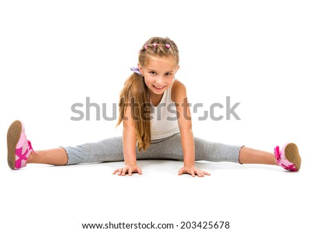 happy cute little girl goes in for sports. studio shot isolated on white background - stock photo