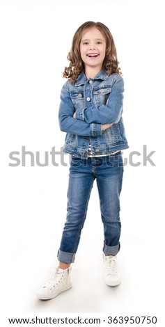 Happy cute little girl in jeans isolated on a white