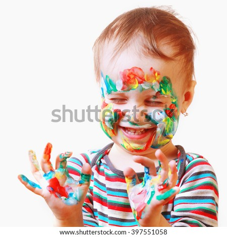 Happy cute little girl with colorful painted hands - stock photo