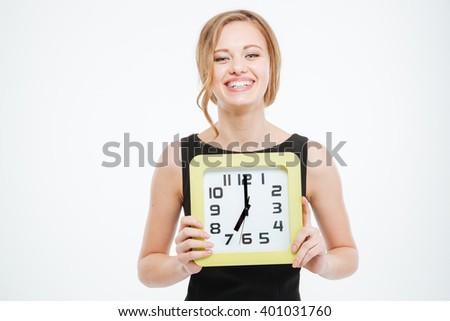 Happy cute young woman holding big clock over white background  - stock photo