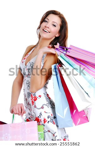 happy cute young woman shopping with color bags - isolated on white - stock photo