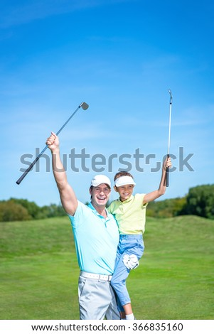 Happy dad and son on golf course