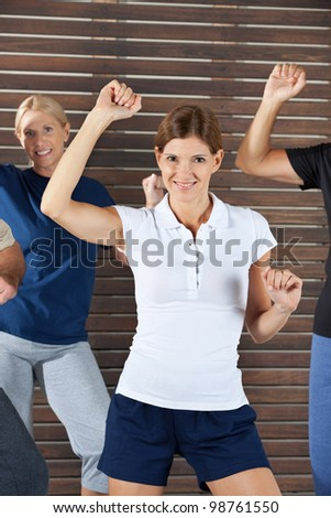 Happy dance instructor in dancing class for senior citizens - stock photo