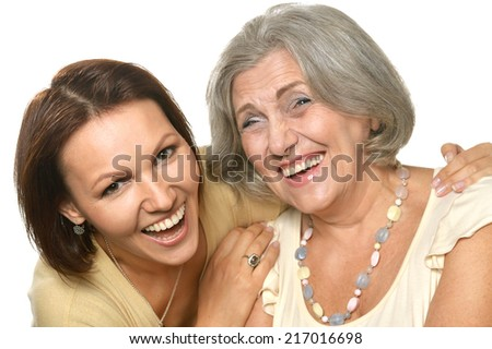 Happy daughter laughing with her mother on a white background - stock photo