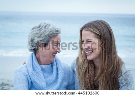 Happy daughter with mother at beach