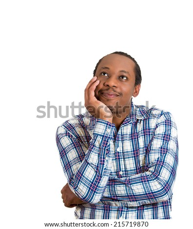 Happy daydreaming man. Portrait upbeat, smiling, joyful young guy looking upwards with chin on hand thinking, isolated white background. Positive human emotion facial expression, feeling body language - stock photo