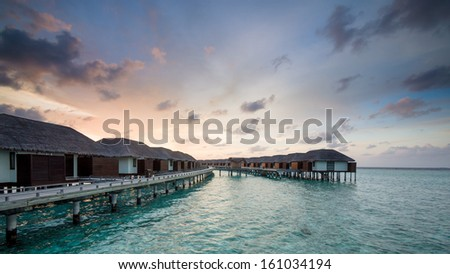 Happy days in Maldives, islands with vivid clear sea water, pretty endless beach, soft white sands,  luxury water villa, straight coconut trees, wonderful sunset and sun rise, blue sky with clouds.