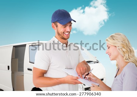 Happy delivery man getting signature from customer against blue sky - stock photo