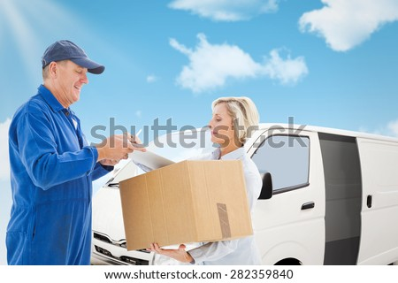 Happy delivery man with customer against blue sky - stock photo