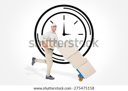 Happy delivery man with trolley of boxes running on white background against clock - stock photo