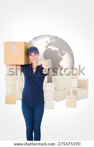 Happy delivery woman holding cardboard box against logistics concept - stock photo