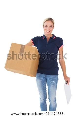Happy delivery woman holding cardboard box and clipboard on white background