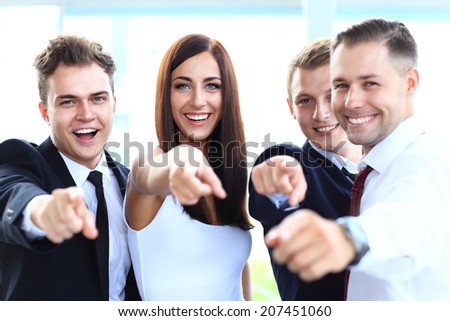 Happy diverse group of executives all pointing at you  - stock photo