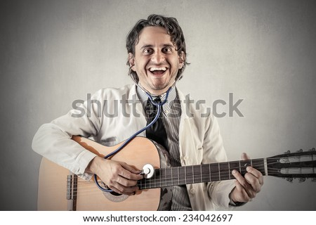 Happy doctor playing the guitar
