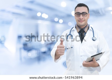 Happy doctor with thumbs up, healthcare concept, with clipping path