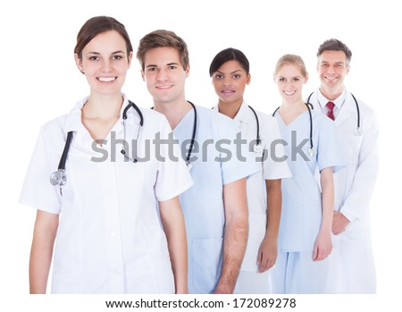 Happy Doctors And Nurses Standing In A Row Over White Background