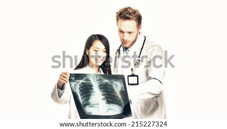 Happy doctors. Caucasian man and asian woman analyzing x-ray. Isolated on white. - stock photo
