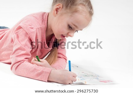 Happy drawing little girl in pink and her painting - stock photo