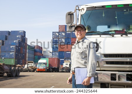 happy driver in front of container truck - stock photo