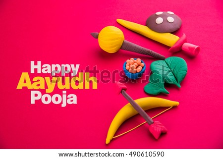 Happy dussehra ayudh puja greeting card stock photo edit now happy dussehra ayudh puja greeting card showing photograph of clay model of arms used in m4hsunfo