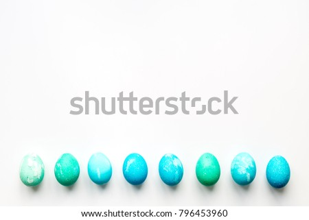 happy Easter! Blue eggs on white background. Lay Flat, top view, mock up.