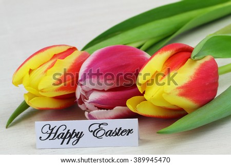 Happy Easter card with three colorful tulips