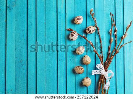 Happy easter concept. Quail eggs and willow branch on a wooden background. Selective focus. Copy  space background - stock photo