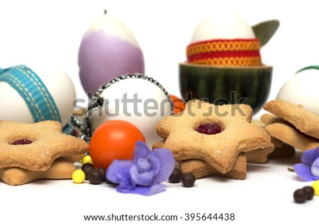 Happy Easter. Easter eggs with biscuits and sweets. Photo.
