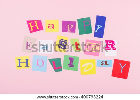 Happy Easter holiday: handmade collage from colorful cut paper letters,  pink background