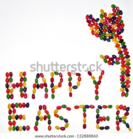Happy Easter message  with a flower made from jelly beans - stock photo