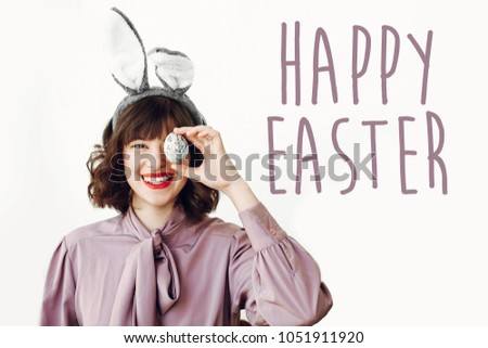 Happy easter text seasons greetings card stock photo royalty free happy easter text seasons greetings card beautiful happy girl in bunny ears holding colored m4hsunfo