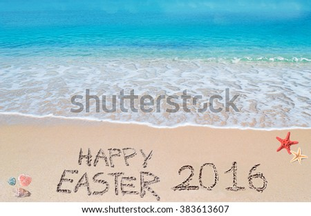 happy easter 2016 written on a tropical beach under clouds