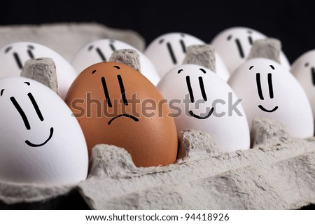 Happy eggs with smiley faces in eggshell - stock photo