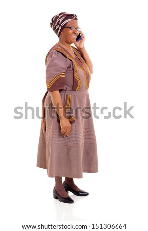 happy elderly african woman talking on cell phone isolated on white - stock photo
