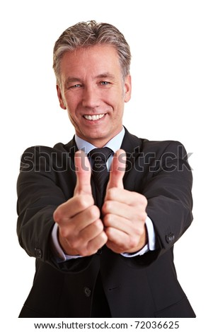 Happy elderly business man holding both his thumbs up - stock photo