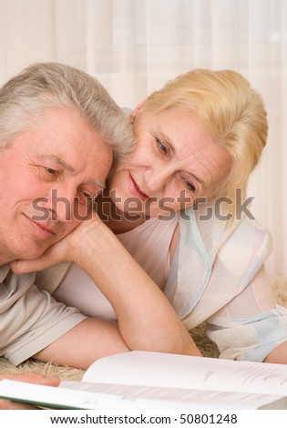 happy  elderly couple along with a book