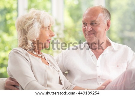 Happy elderly couple gazing into each other's eyes