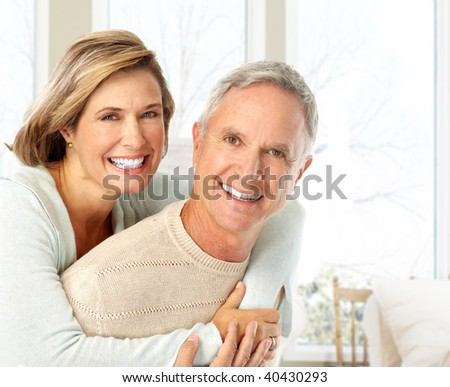 Happy elderly couple in love at home - stock photo