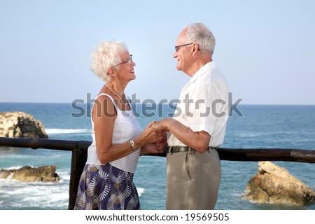 happy elderly couple in love, holding hands - stock photo