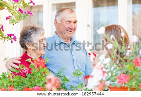 Happy elderly couple talking with the therapist - stock photo
