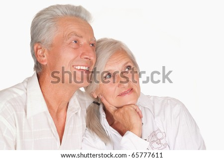 happy elderly couple together on a white - stock photo