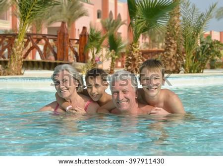 Happy Elderly couple with grandsons - stock photo