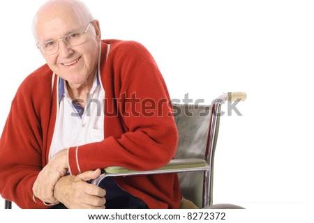 happy elderly man in wheelchair - stock photo