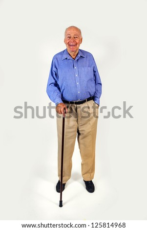 happy elderly man standing with his walking stick isolated on white