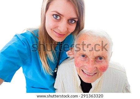 Happy elderly patient and doctor on a photograph taken by the healtcare worker - recovery selfie. - stock photo