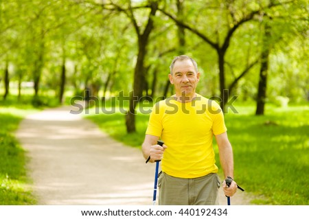 Happy elderly people engaged in Nordic walking