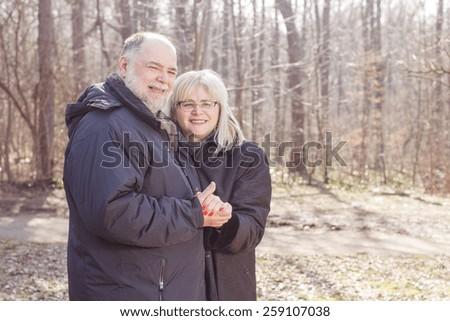 Happy Elderly Senior Romantic Couple in nature, Old people portrait outdoor winter autumn season. - stock photo