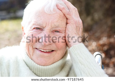 Happy Elderly Woman in Wheelchair Smiling - stock photo