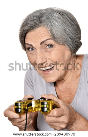 Happy elderly woman play video game isolated on white background - stock photo