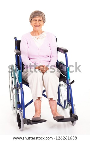 happy elderly woman sitting on wheelchair isolated on white - stock photo